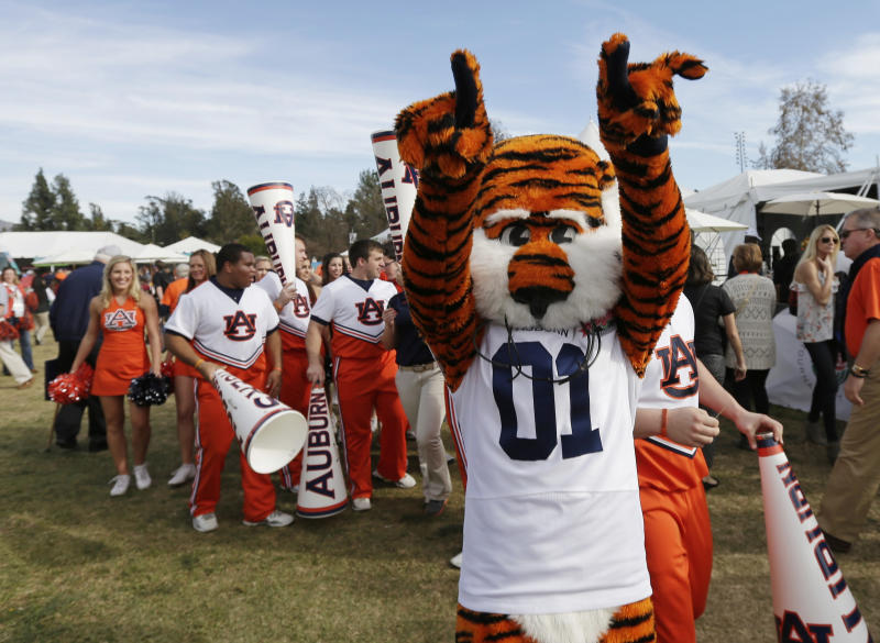 "Auburn mascot ""Aubie"" greets fans as they arrive before the NCAA BCS National Championship college football game between Florida State and Auburn Monday, Jan. 6, 2014, in Pasadena, Calif. (AP Photo/Gregory Bull)"