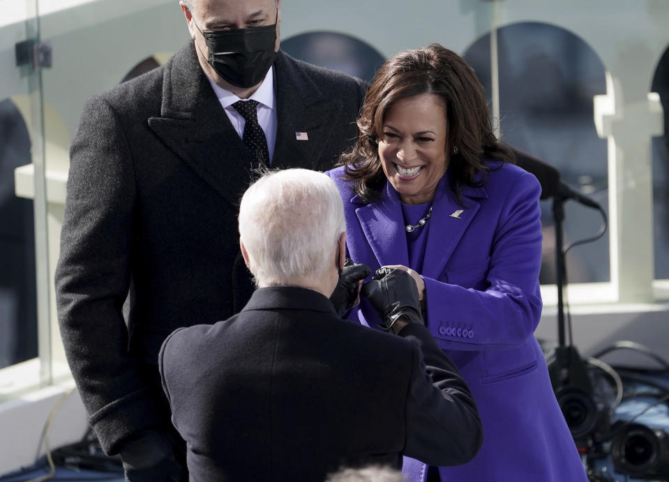 Vice President Kamala Harris bumps fists with President-elect Joe Biden after she was sworn in during the inauguration, Wednesday, Jan. 20, 2021, at the U.S. Capitol in Washington. (Greg Nash/Pool Photo via AP)