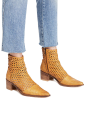 """<p><strong>FP Collection</strong></p><p>freepeople.com</p><p><strong>$168.00</strong></p><p><a href=""""https://go.redirectingat.com?id=74968X1596630&url=https%3A%2F%2Fwww.freepeople.com%2Fshop%2Fin-the-loop-woven-boot%2F&sref=https%3A%2F%2Fwww.marieclaire.com%2Ffashion%2Fg33469548%2Fbest-ankle-boots-for-women%2F"""" rel=""""nofollow noopener"""" target=""""_blank"""" data-ylk=""""slk:SHOP IT"""" class=""""link rapid-noclick-resp"""">SHOP IT</a></p><p>I'm a yes when it comes to woven footwear, which is why I gravitated towards this bootie. It comes in two colors, so if the mustard yellow isn't for you, try the light grey. Wear socks if you wish, though I'd go without. </p>"""
