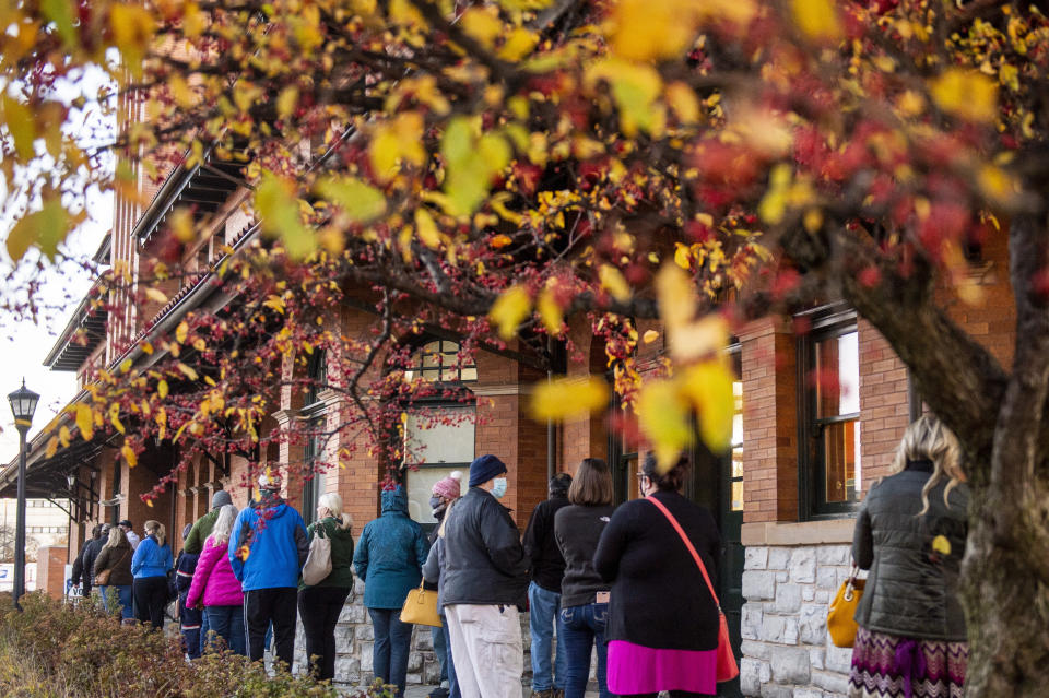 FILE - In this Tuesday, Nov. 3, 2020, file photo, voters stand in line outside of Pere Marquette Depot to cast their ballots in Bay City, Mich., on Election Day. In a move Monday, Aug. 30, 2021, Republicans are launching a ballot drive to tighten Michigan's voting and election laws, backing a maneuver that would let GOP lawmakers enact the changes without Gov. Gretchen Whitmer's signature. (Kaytie Boomer/The Bay City Times via AP, File)