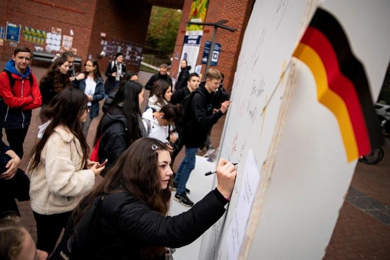 FILE PHOTO: Georgetown students erect a replica Berlin Wall for to mark the 30th anniversary of the fall of the Berlin Wall