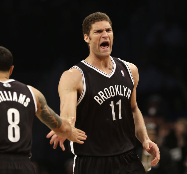 Brooklyn Nets' Brook Lopez, right, reacts after scoring against the Chicago Bulls during the first quarter of Game 1 of a first-round series of the NBA basketball playoffs, Saturday, April 20, 2013, in New York. (AP Photo/Seth Wenig)