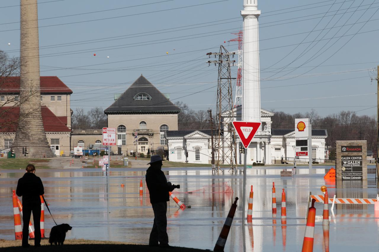 <p>Louisville residents watch the water after Ohio River flooded Louisville, Ky., Feb. 26, 2018. (Photo: John Sommers II/Reuters) </p>
