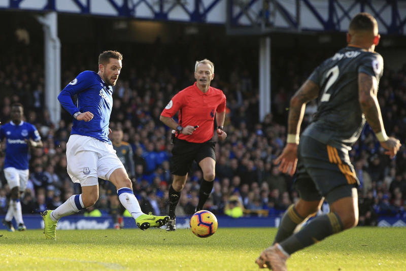 Everton's Gylfi Sigurdsson in action against Leicester City, during their English Premier League soccer match at Goodison Park in Liverpool, England, Tuesday Jan. 1, 2019. (Peter Byrne/PA via AP)