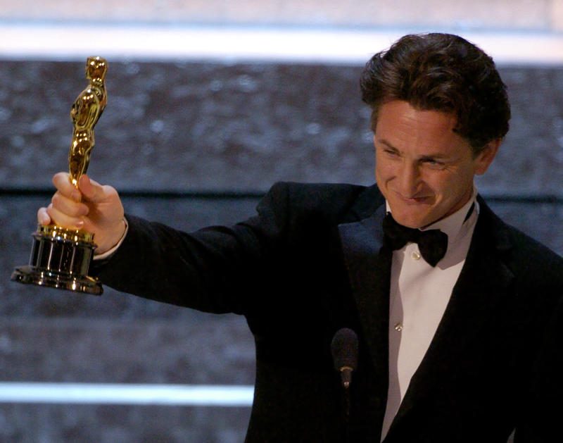 Actor Sean Penn accepts the Oscar for best actor for his work in Mystic River at the 76th annual Academy Awards Sunday, Feb. 29, 2004, in Los Angeles. (AP Photo/Mark J. Terrill)