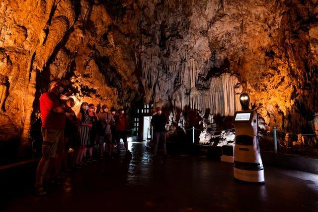 Persephone guides visitors inside Alistrati cave, north-east of Thessaloniki, Greece