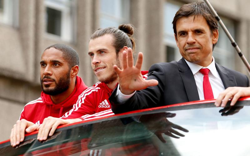 Wales' Gareth Bale (centre) and Ashley Williams (left) with manager Chris Coleman (right) acknowledge the fans on a open top bus during the homecoming in Cardiff City centr - PA Wire/Paul Harding