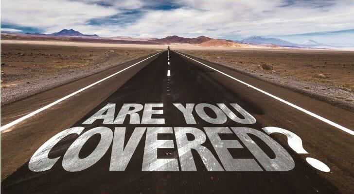 """""""ARE YOU COVERED"""" written on a highway"""