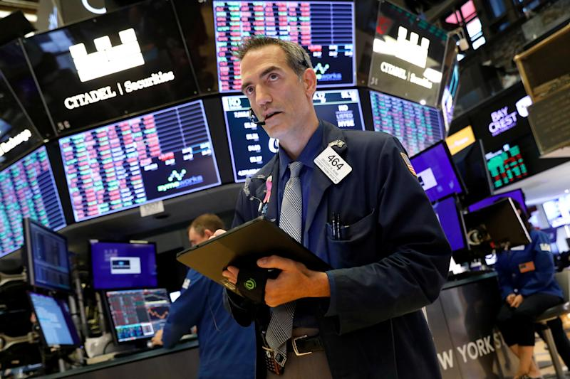Traders work on the floor at the New York Stock Exchange (NYSE) in New York, U.S., September 12, 2019. REUTERS/Brendan McDermid