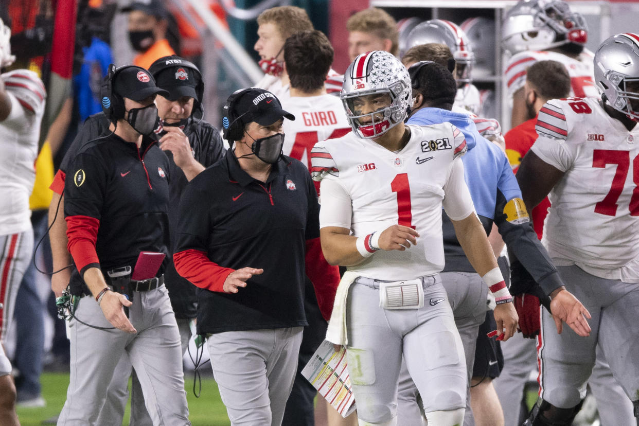 MIAMI GARDENS, FL - JANUARY 11: Ohio State Buckeyes quarterback Justin Fields (1) speaks with Ohio State Buckeyes head coach Ryan Day on the sidelines during the College Football Playoff National Championship football game between the Alabama Crimson Tide and the Ohio State Buckeyes on January 11, 2021 at the Hard Rock Stadium in Miami Gardens, FL. (Photo by Doug Murray/Icon Sportswire via Getty Images)