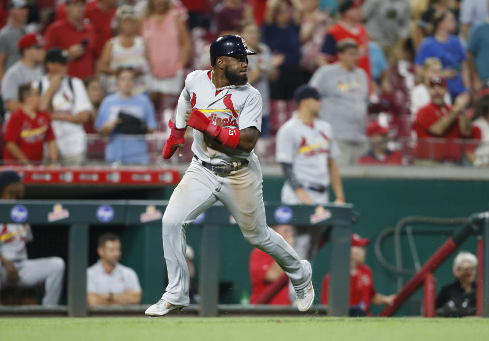 St. Louis Cardinals' Dexter Fowler rounds third base to score on a single by Kolten Wong off Cincinnati Reds relief pitcher Raisel Iglesias during the ninth inning of a baseball game Thursday, Aug. 15, 2019, in Cincinnati. (AP Photo/Gary Landers)