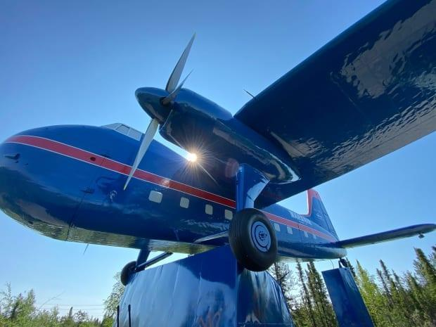 The historic plane at the entrance into Yellowknife sits at an entry point to Yellowknife as a monument to aviation and its role in opening up Canada's North. But for Ernie Bernhardt, it represents something more ominous: the role of aviation in ferrying Indigenous children to residential schools away from their homes.  (Chantal Dubuc/CBC - image credit)