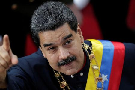 Venezuela's President Nicolas Maduro gestures as he arrives for a session of the National Constituent Assembly at Palacio Federal Legislativo in Caracas