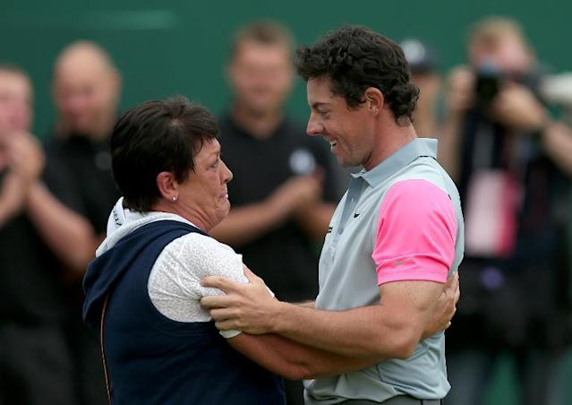 Northern Ireland's Rory McIlroy celebrates with his mother Rosie on the 18th green winning the Open Championship after his fourth round 71, in Hoylake, England on July 20, 2014 (AFP Photo/Andrew Yates)