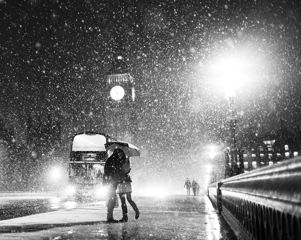 'London when it Snows: Big Ben and Lovers', Westminster Bridge, London: Kayode Okeyode spent around 30 minutes in the snow taking photographs before capturing this image of a couple and a bus in the background. The photo was commended in Living the View category and won the Calumet 'This Is Britain' Award. (Kayode Okeyode, Landscape Photographer of the Year)