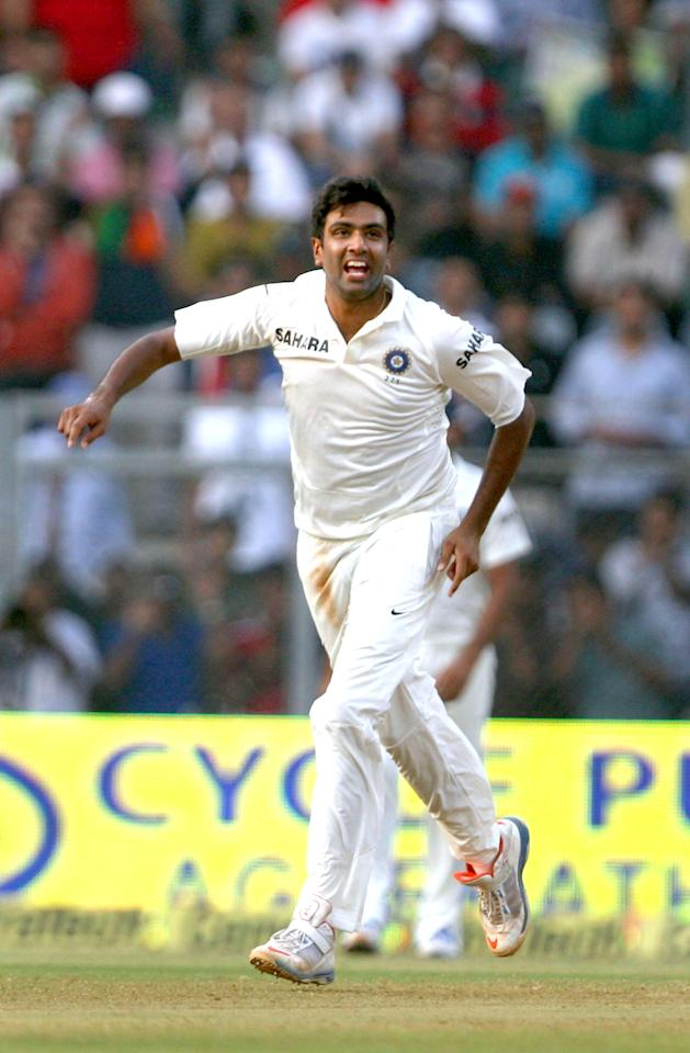 Indian cricketer Ravichandran Ashwin celebrates after taking a wicket during the 2nd day of the 2nd Test Match between India and West Indies at Wankhede Stadium in Mumbai on Nov.15, 2013. (Photo: IANS)
