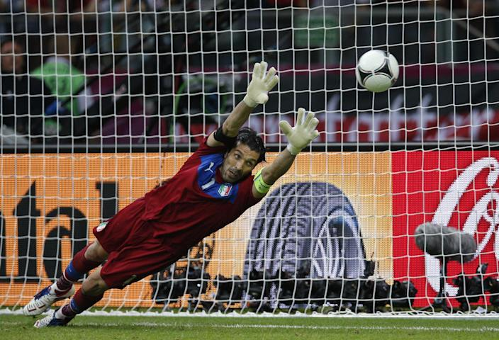 Italy goalkeeper Gianluigi Buffon fails to save a penalty during the Euro 2012 soccer championship semifinal match between Germany and Italy in Warsaw, Poland, Thursday, June 28, 2012. (AP Photo/Michael Sohn)
