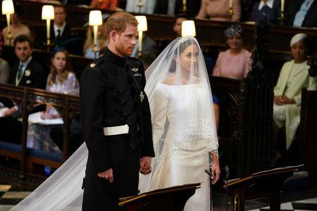 Prince Harry and Meghan Markle in St George's Chapel at Windsor Castle for their wedding in Windsor, Britain, May 19, 2018. Dominic Lipinski/Pool via REUTERS