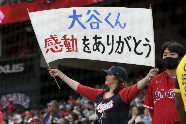 A Los Angeles Angels' fan holds a sign thanking pitcher Shohei Ohtani during a baseball game against the Seattle Mariners, Sunday, Sept. 26, 2021, in Anaheim, Calif. The Mariners won 5-1. (AP Photo/Michael Owen Baker)