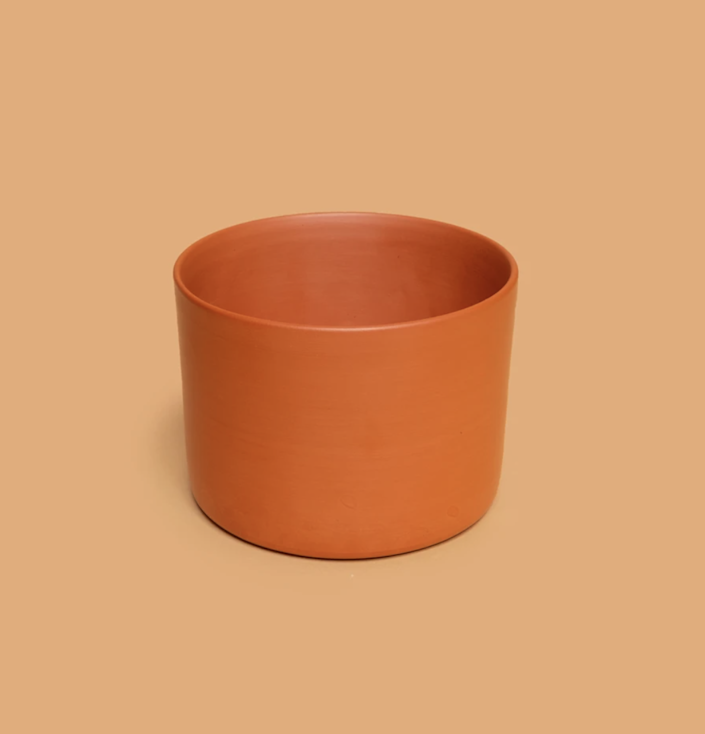 """Anything but basic, this terra-cotta planter streamlines the classic ridges for a simple, refreshing silhouette. $25, Tula House. <a href=""""https://tula.house/collections/planters-1/products/hazel-terracotta-planter#"""" rel=""""nofollow noopener"""" target=""""_blank"""" data-ylk=""""slk:Get it now!"""" class=""""link rapid-noclick-resp"""">Get it now!</a>"""
