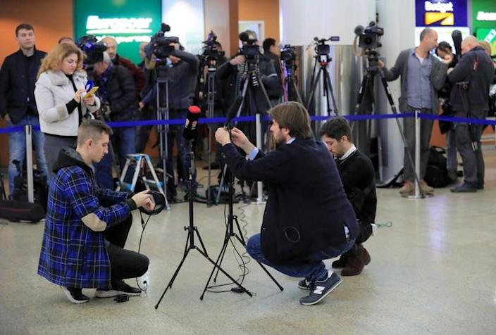 Journalists wait for convicted Russian agent Butina deported after U.S. jail release at an airport outside Moscow