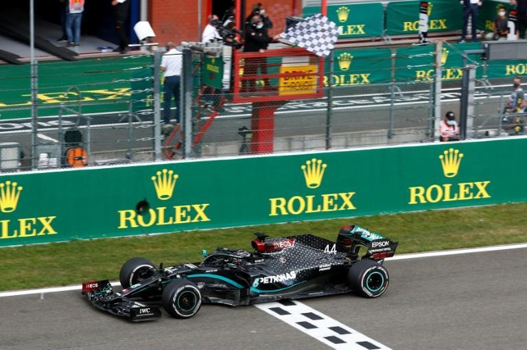 Chequered flag: Lewis Hamilton won in Belgum for his 89th Grand Prix victory