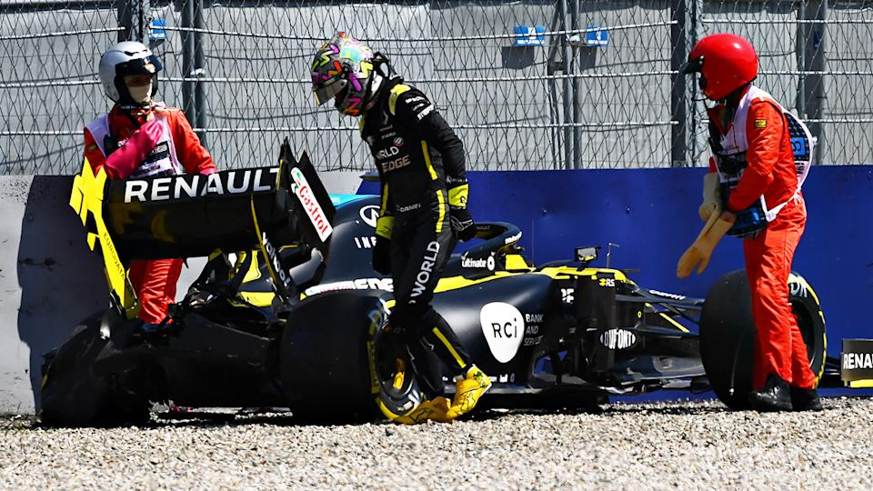 Daniel Ricciardo, pictured here walking away from the scary crash.