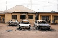 Burnt vehicles are seen outside the Nigeria police force Imo state command headquaters after gunmen attacked and set properties ablaze in Imo State