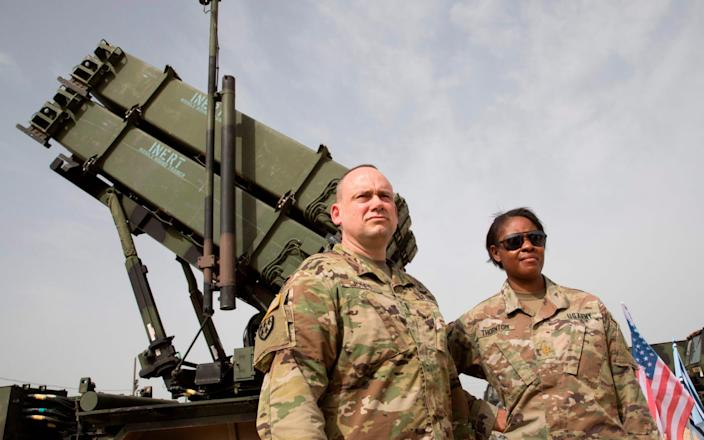 US army officers stand in front a US Patriot missile defence system - AFP