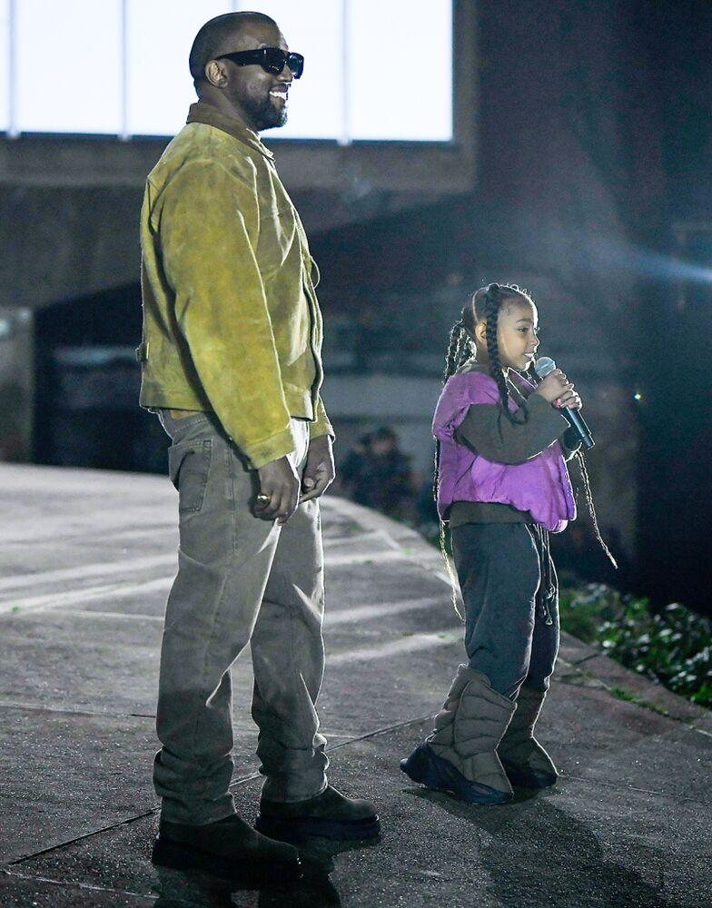 Kanye West and daughter North West | WWD/Shutterstock