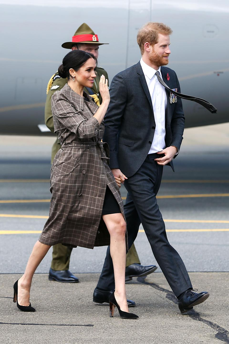 "<p>After a quick outfit change, the Duchess touched down in New Zealand wearing a £35 ASOS maternity <a href=""https://www.asos.com/asos-maternity/asos-design-maternity-wiggle-mini-dress/prd/10415635?clr=black&SearchQuery=asos%20design%20maternity%20wiggle%20dress&gridcolumn=1&gridrow=1&gridsize=4&pge=1&pgesize=72&totalstyles=4"" rel=""nofollow noopener"" target=""_blank"" data-ylk=""slk:dress"" class=""link rapid-noclick-resp"">dress</a> with a Karen Walker plaid trench to finish the ensemble. <em>[Photo: Getty]</em> </p>"