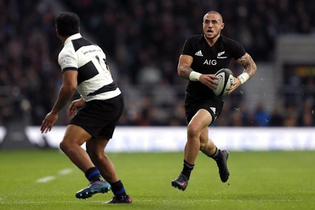 New Zealand's TJ Perenara (R) has said homophobic comments like the ones made recently by Israel Folau cannot be tolerated (AFP Photo/Adrian DENNIS)