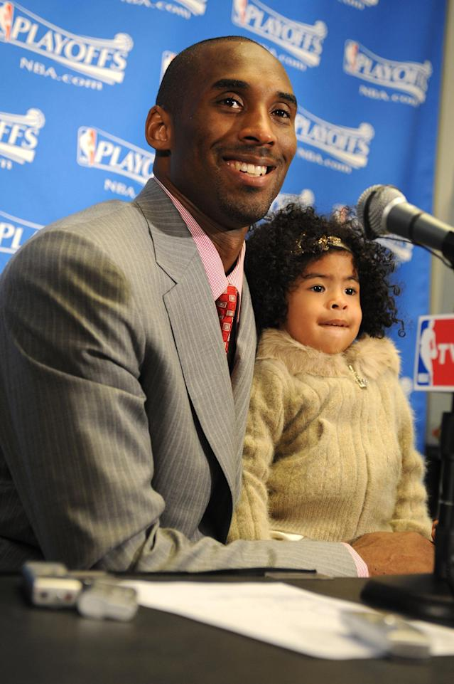Kobe Bryant #24 of the Los Angeles Lakers answers questions from the media while holding his daughter Gianna, following his team's victory over the Utah Jazz in Game One of the Western Conference Semifinals during the 2008 NBA Playoffs at Staples Center on May 4, 2008 in Los Angeles, California. (Photo by Andrew D. Bernstein/NBAE via Getty Images)