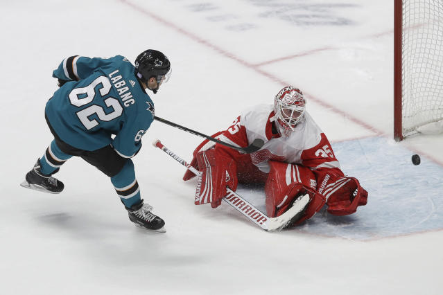 San Jose Sharks right wing Kevin Labanc (62) scores past Detroit Red Wings goaltender Jimmy Howard in the shootout of an NHL hockey game in San Jose, Calif., Saturday, Nov. 16, 2019. The Sharks won 4-3. (AP Photo/Jeff Chiu)