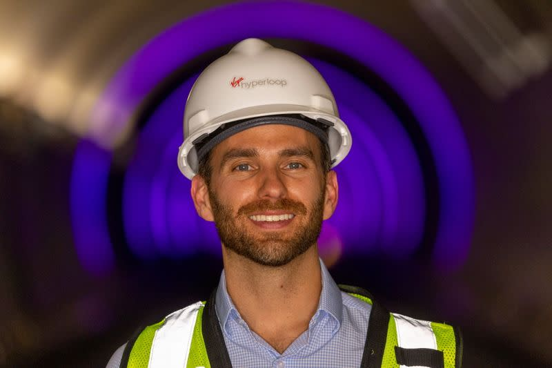 FILE PHOTO: Josh Giegel, co-founder and CEO of Virgin Hyperloop, poses inside a hyperloop tube at the company's hyperloop facility near Las Vegas