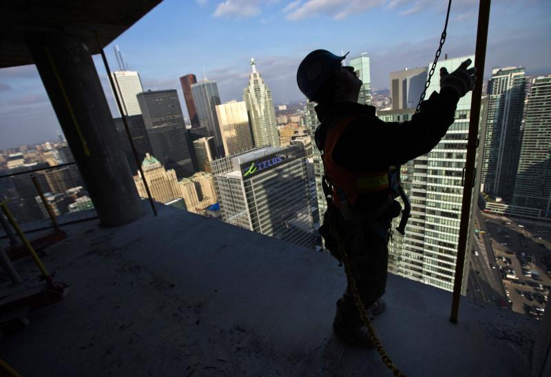 "File photo of a construction worker standing at the ""ICE Condominiums"" development site by Cadillac Fairview and Lanterra Developments in Toronto"