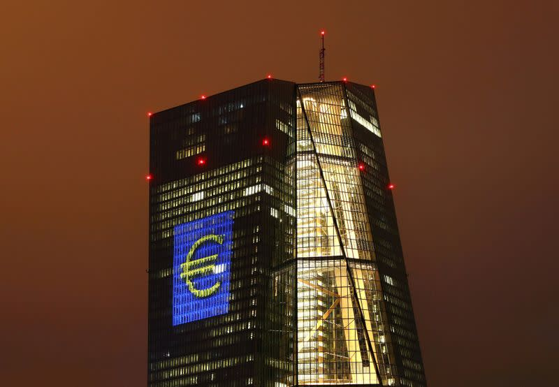 """FILE PHOTO: Headquarters of the European Central Bank (ECB) is seen illuminated with a giant euro sign at the start of the """"Luminale, light and building"""" event in Frankfurt"""