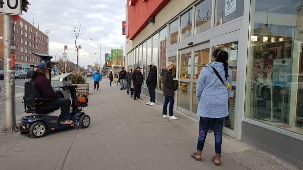 One Shoppers Drug Mart location in Toronto's east end started catering to walk-ins — first come, first served — which prompted a long lineup near Danforth and Coxwell Avenues on Thursday.