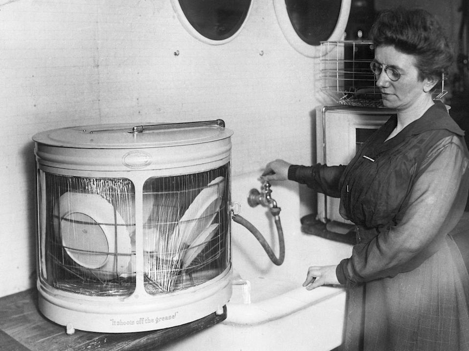 A woman with one of the earliest dishwashers.
