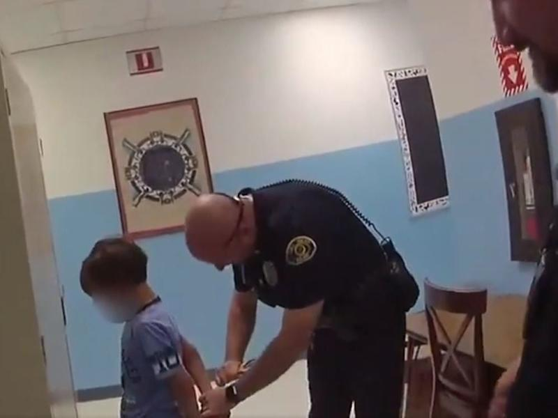 A police officer in Key West, Florida arrests an 8-year-old boy with special needs after he punched a teacher in the chest: Key West Police Department