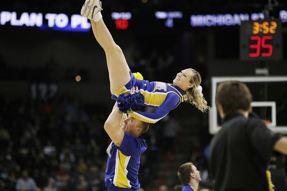 Delaware's cheerleaders perform during the second-round game of the NCAA men's college basketball tournament against Michigan State, in Spokane, Wash., Thursday, March 20, 2014. (AP Photo/Young Kwak)