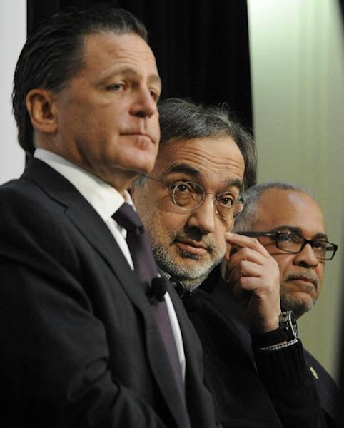 From left, Chairman of Rock Ventures and Quicken Loans Dan Gilbert, Fiat-Chrysler CEO Sergio Marchionne and Detroit Deputy Mayor Kirk Lewis hold a news conference to announce that Chrysler is setting up a downtown office for Marchionne and up to 70 staffers at the Dime Building in Detroit, on Monday, April 30, 2012. (AP Photo/The Detroit News, Daniel Mears)
