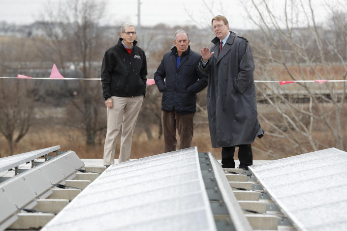 Michael Bloomberg, center, looks at solar panels with former Paulson Electric Co. president Ron Olson, left, and Iowa state Sen. Rob Hogg in Cedar Rapids in December. (Photo: Charlie Neibergall/AP)