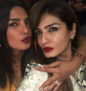 <p>Ever since Nick Jonas proposed to his girlfriend of two months, Priyanka Chopra, at the end of July we've been desperate to get a look at the ring. And it hasn't disappointed.<br>Chopra showed off the sparkler for the first time in a snapshot with her friend, and Bollywood actress, Raveena Tandon on Instagram.<br>According to sources the ring is a customised Tiffany & Co. cushion cut diamond with tapered baguettes and just like its new owner it's an absolute beaut! <em>[Photo: Instagram/officialraveenatandon]</em> </p>