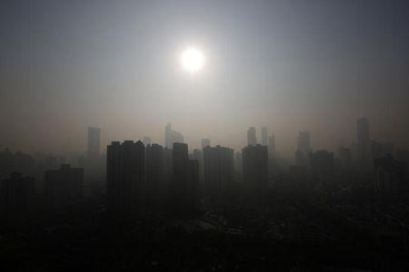 Buildings are seen through thick haze in downtown Shanghai