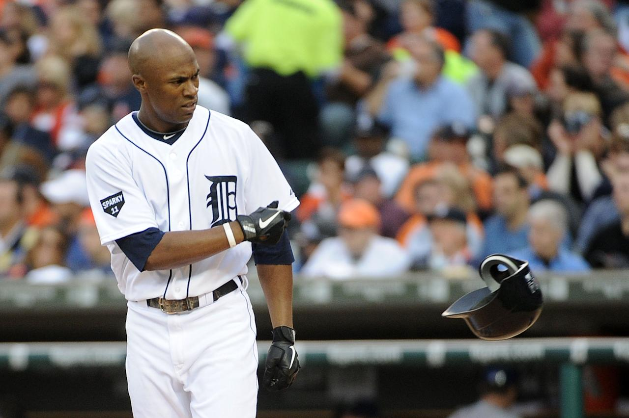 DETROIT, MI - OCTOBER 13: Austin Jackson #14 of the Detroit Tigers reacts after striking out in the fifth inning of Game Five of the American League Championship Series against the Texas Rangers at Comerica Park on October 13, 2011 in Detroit, Michigan.  (Photo by Harry How/Getty Images)