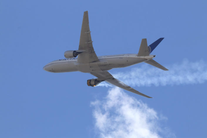 """This Saturday, Feb. 20, 2021 photo provided by Hayden Smith shows United Airlines Flight 328 approaching Denver International Airport, after experiencing """"a right-engine failure"""" shortly after takeoff from Denver. Federal regulators are investigating what caused a catastrophic engine failure on the plane that rained debris on Denver suburbs as the aircraft made an emergency landing. Authorities said nobody aboard or on the ground was hurt despite large pieces of the engine casing that narrowly missed homes below. (Hayden Smith via AP)"""