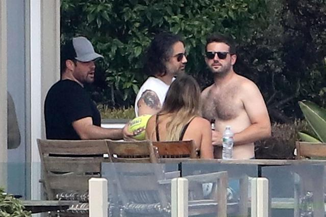 Hilary Duff with her ex-husband, Mike Comrie (in the hat), in Malibu, Calif. (Photo: AKM-GSI)