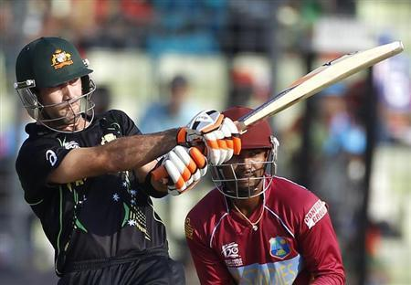 Australia's Glenn Maxwell plays a ball as West Indies' wicketkeeper Denesh Ramdin (R) watches during their ICC Twenty20 World Cup match at the Sher-E-Bangla National Cricket Stadium in Dhaka March 28, 2014. REUTERS/Andrew Biraj