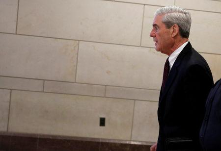 Mueller departs after briefing the U.S. House Intelligence Committee on Capitol Hill in Washington